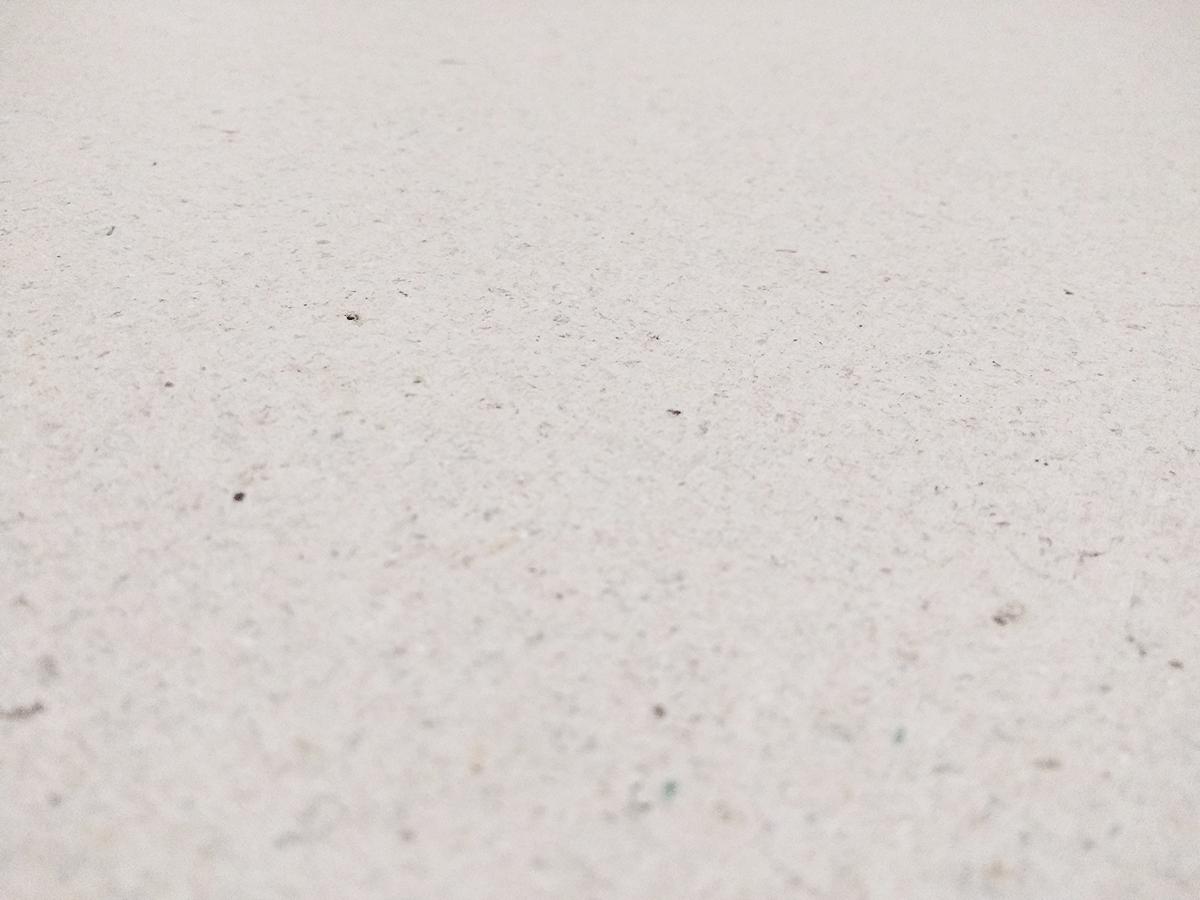 Het oppervlak van een gipsvezelplaat